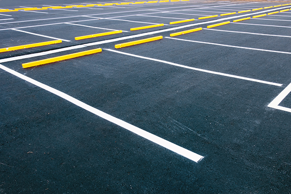 a freshly seal coated and painted parking lot